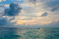 Wakeboarding at sunset time at Maldives Stock Photo