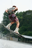 Wakeboarding Teen Boy. Teenage boy wakeboarding on the lake Royalty Free Stock Photos