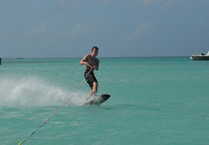 Wakeboarding Teen Carving on the Waters off Aruba Stock Photo