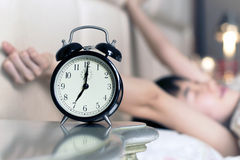 Waked Up by the Noise of Alarm clock Royalty Free Stock Photos