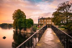 Walton Hall in a scenic setting of rolling parkland with its own Royalty Free Stock Photo