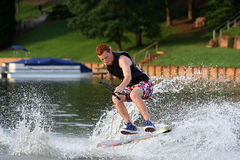Wakeskate Jump. Young adult boy performing a trick on the wakeskate Stock Image