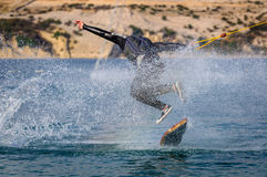 Wakeskater in a cable park doing tricks. Wakeskater in a (wakeboarding) cable park doing tricks Royalty Free Stock Photos