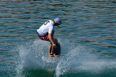 Wakeskater start run with jump Stock Photo