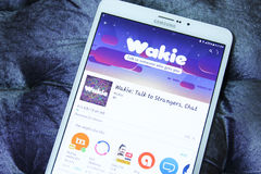 Wakie talk, chat mobile app. Downloading wakie talk, chat mobile application from google play store on samsung tablet s2 Royalty Free Stock Photo
