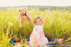 Waking little girl on nature Stock Photos