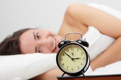 Waking up. Beautiful Caucasian woman waking up in the morning Royalty Free Stock Photo