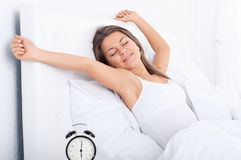 Waking up. Bedtime collection: woman in bed waking up Royalty Free Stock Photo