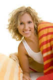 Waking up. Young blonde woman in bed smiling stock images