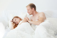 Waking up in bed Royalty Free Stock Photography