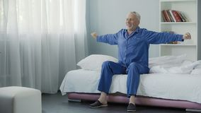 Waking up full of energy cheerful pensioner doing morning gymnastics, new day. Stock footage Royalty Free Stock Photo