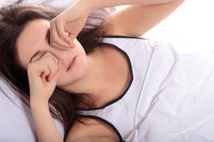 Waking up in the morning. A young woman waking up in the morning Royalty Free Stock Image