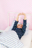 Waking up in the morning. Middle aged woman waking up in the morning Stock Photo
