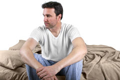 Waking Up Worried. Young male waking up and looking worried about the day Royalty Free Stock Photography