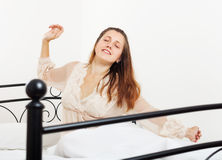 Waking  woman in nightrobe Stock Photo