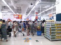 WAL-MART supermarket cashier customers waiting in line to pay. In the Central District of Shenzhen, Baoan, China royalty free stock image