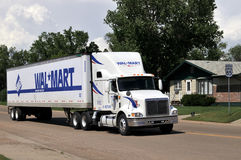 Wal-Mart truck. BOWMAN - June 18: The recession has brought wealthier customers to Wal-Mart looking for bargains, the AP reports. Wal-Mart truck driving through Royalty Free Stock Image