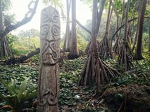 Walarano village, Malekula Island / Vanuatu - 9 JUL 2016 : carved wood totem statue as a warning sign just outside of the village.  royalty free stock photos