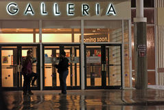 Walden Galleria shopping mall entrance at night, Buffalo NY. People at mall entrance at night time Royalty Free Stock Image
