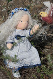 Waldorf doll and bird. At the nature royalty free stock photography
