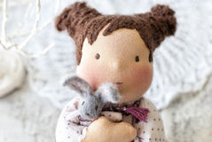 Waldorf doll with a rabbit. Lovely waldorf doll with a rabbit Stock Photos