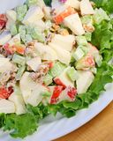 Waldorf salad. Crisp refreshing waldord salad made with apples, celery and walnuts. served on a bed of leaf lettuce Stock Photos
