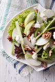 Waldorf Salad with apples, celery and walnuts close-up. vertical Stock Photos