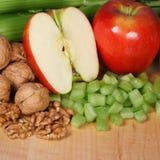 Waldorf salad ingredients. Celery apples and walnuts, main ingredients for a waldorf salad stock photos