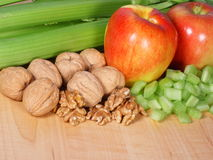 Waldorf salad ingredients. Celery apples and walnuts, main ingredients for a waldorf salad royalty free stock photography
