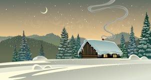 Waldwinterlandschaft mit einer Hütte Stockfotos