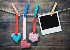 Walentynek ciastek i obrazek ramy obwieszenie Obrazy Stock
