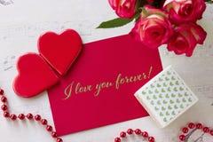 Walentynka dnia kartka z pozdrowieniami z róża prezenta pudełka sercami i literowanie kocham ciebie na zawsze Fotografia Stock