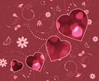 Walentynka dnia powitania Rozmyci czerwoni serca i ślimakowaty kwiecisty wzór Fotografia Stock