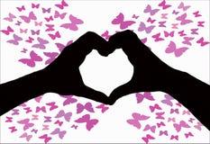 Walentynka dnia tło, sylwetka dwa ręki robi kierowemu kształtowi wpólnie na białym tle z motylem fotografia royalty free