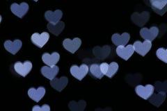Walentynka Kolorowy sercowaty biel na czarnego tła oświetleniowym bokeh dla dekoraci przy nocy tła tapetą zamazywał wartościowośc Zdjęcie Stock