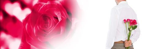 Walentynka mężczyzna mienia róże z miłość serc tłem fotografia royalty free