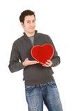 Walentynka: Mężczyzna Pokazuje Daleko Kierowego cukierku pudełko Fotografia Royalty Free