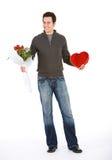 Walentynka: Ufny mężczyzna z kwiatami i czekoladami dla Valen Zdjęcia Royalty Free