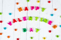 Walentynki karta z Szczęśliwym walentynki czerwieni i teksta dzianiem on Fotografia Stock
