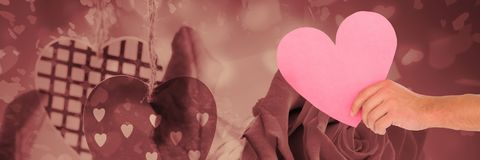 Walentynki kierowe w ręce z miłość serc tłem Obraz Royalty Free