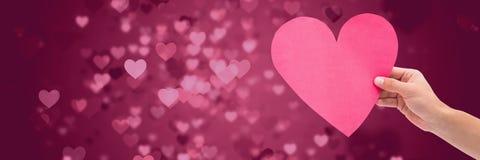 Walentynki kierowe w ręce z miłość serc tłem Obrazy Royalty Free