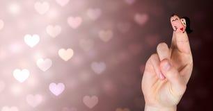 Walentynki ` s palców miłości para i kolorowi bokeh serca światła Zdjęcia Royalty Free
