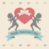 Walentynki serce z Dwa Sylwetkowymi amorkami Zdjęcia Stock