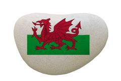 Wales emblem painted on a message stone. royalty free stock photo