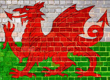 Wales flag on a brick wall background Royalty Free Stock Photo