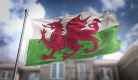 Wales Flag 3D Rendering on Blue Sky Building Background Royalty Free Stock Photos