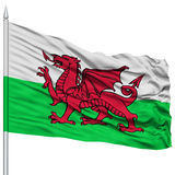 Wales Flag on Flagpole. Flying in the Wind, Isolated on White Background Stock Image
