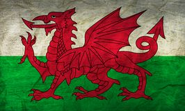 Wales Flag on Paper. Flag on an old Paper Texture Royalty Free Stock Image