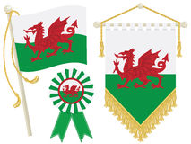 Wales flags. Wales flag, rosette and pennant, isolated on white Royalty Free Stock Photo