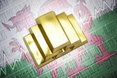 Wales gold reserves. Shining golden bullions lie on a wales flag background Royalty Free Stock Image